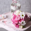 Beautiful wedding still life with bouquet on wooden chair — Stock Photo #49877533