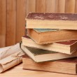 Old books on table on wooden background — Stock Photo #49878467