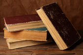 Old books on table on brown background — Stock Photo