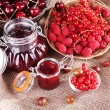 Berries jam in glass jar on table, close-up — Stock Photo #49880781