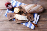 Fresh toast with homemade butter and blackcurrant jam on wooden background — Stock Photo