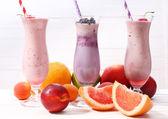 Delicious milkshakes on table, close-up — Stockfoto