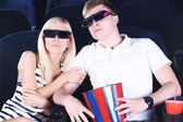 Young couple watching movie in cinema — Stock Photo