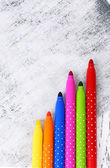 Bright markers on wooden table close-up — Stock Photo