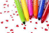Bright markers on colorful paper close-up — Foto Stock