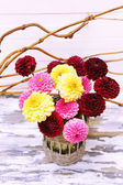 Dahlia flowers in vase on wooden table — Stock Photo