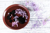 Bowl with  natural spa ingredients and perfumed water on wooden background — Stock Photo