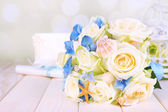Beautiful wedding bouquet with sea decor on wooden table — Stock Photo