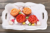 Tasty cupcakes on wooden table — Stock Photo