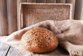 Fresh bread on wooden table — Stock Photo