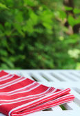 Wooden table with tablecloth, outdoors — Stock Photo