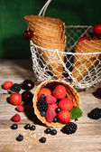 Different ripe berries in sugar cone — Stock Photo