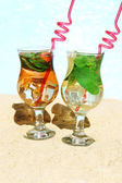 Delicious cocktails on beach — Stock Photo