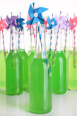 Bottles of drink with straw — ストック写真
