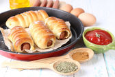 Baked sausage rolls in pan — Stock Photo