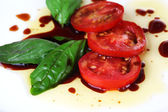Balsamic vinegar, tomato and basil — Stock Photo