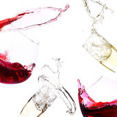 Glasses with red wine and champagne — Stockfoto