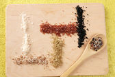 Sea salt on wooden board — Stock Photo