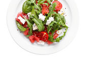 Salad with watermelon, feta, arugula and basil leaves — Foto de Stock