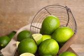 Fresh juicy limes in basket — Foto de Stock