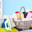 Basket with laundry and ironing board — Stock Photo