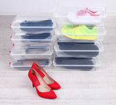 Shoes in plastic boxes — Stock Photo