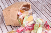Tasty candies in paper bag — Stock Photo