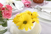 Table setting with spring flowers — Stok fotoğraf