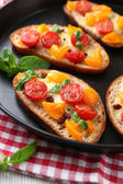 Tasty bruschetta with tomatoes — Stock Photo
