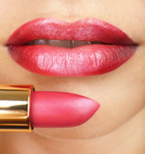 Beautiful female lips with lipstick — Stock Photo