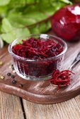 Grated beetroots in bow — Stock Photo