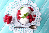 Creamy ice cream with raspberries — Stock Photo