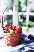 Forest berries in wicker basket — Stock Photo
