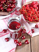Berries jam in glass jar — Stock Photo