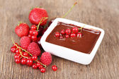 Ripe berries and liquid chocolate — Stock Photo
