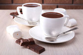 Cups of hot chocolate on table — Stock Photo