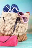 Summer wicker bag with accessories — Stock Photo
