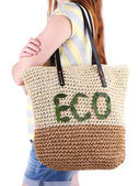 Woman with wicker Eco bag — Stockfoto