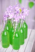 Bottles of drink with straw — Stok fotoğraf
