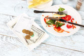 Check and remnants of food — Stock Photo