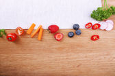 Different slices of vegetables and berries — Stock Photo