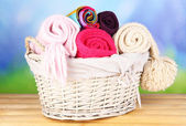 Warm knitted scarves in basket — Stok fotoğraf
