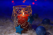 Candle on blur lights background — Stock Photo