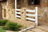Stone wall with wooden fence — Stock Photo