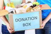 Volunteers with donation box — Stock Photo