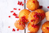 Tasty muffin with red currant — Stock Photo