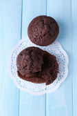 Chocolate muffin on wooden background — Stock Photo