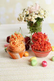 Tasty cupcakes on table — Stock Photo