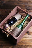 Bottles of wine in wooden box — Stock Photo
