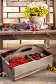 Fresh berries in wooden box — Stock Photo